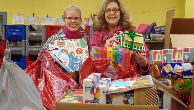 Tammy Young, executive director BBBS, and Joanne Schneider, of Mid-States Aluminum, pose with presents.