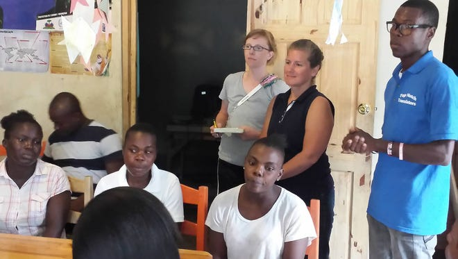 """Tricia and Deanna at their first """"mom meeting."""" The Belle Plaine natives are helping a relief effort in Haiti."""