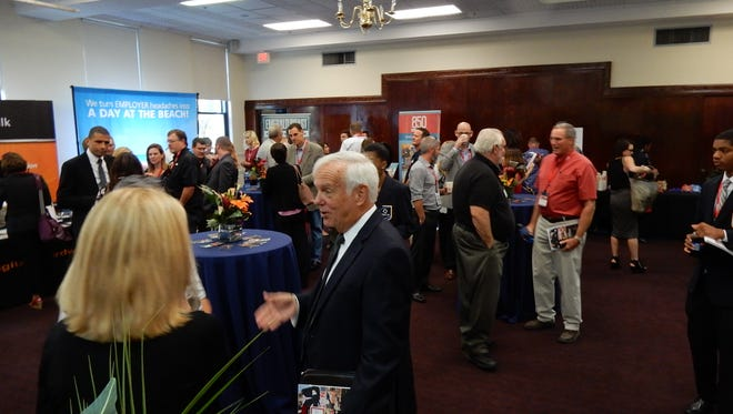 Attendees at EntreCon network at the Pensacola Little Theatre.