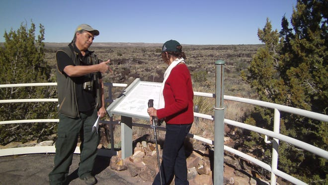 Larry Cordova, right, Wildlife Biologist with Smokey Bear Ranger Station in Ruidoso, verifies an observation by Barbara Willard, left, of Lincoln County Bird Club.