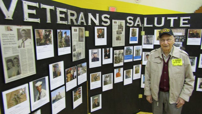 WWII veteran John Stark is one of many local veterans honored with a photograph on the Veterans Salute wall which will be on display during Fairview High School's Veterans Day assembly on Monday, November 12  starting at 9 a.m. and open to all veterans and the public.