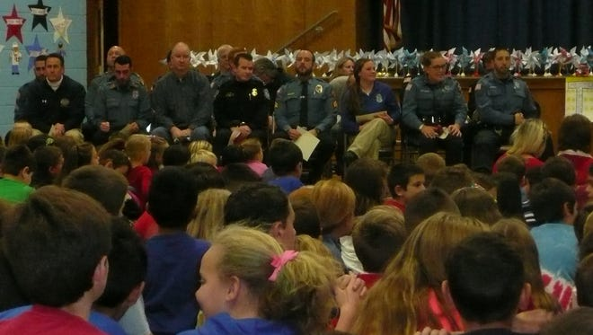 Nearly two dozen first responders from in and around the West Milford community were recognized during a Nov. 22, 2016 assembly at the community's Maple Road school.