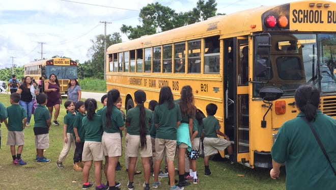 P.C. Lujan Elementary School students are picked up by school buses to be sent home after authorities evacuated the campus because of found ordnance the morning of Jan. 24, 2017.