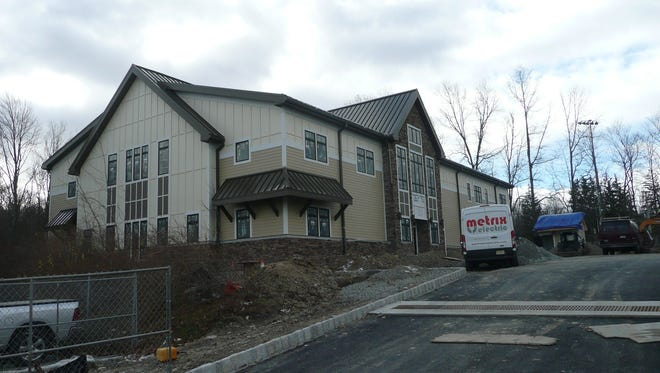 West Milford's new library, as it appeared in November. A recent well-drilling success could see the library open in March.