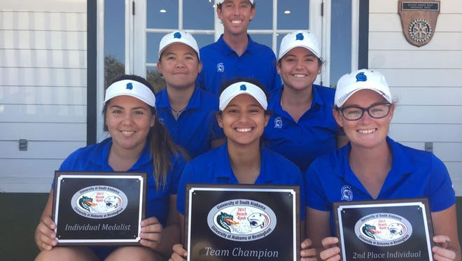 The UWF golf team seated in front of head coach Bryan Clarke, swept awards at the Bama Beach Blast Tournament, which concluded Sunday in Gulf Shores, Alabama.