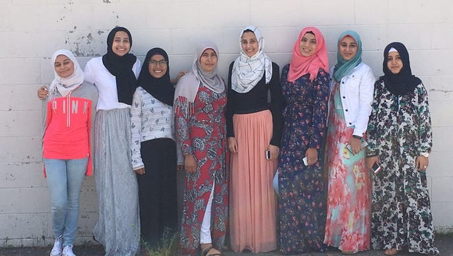 A group of Muslim girls, shown here in a September photo at the Islamic Center of Wisconsin in Appleton, will host a Friday event at the Neenah-Menasha YMCA to talk about being a Muslim in the Fox Cities.