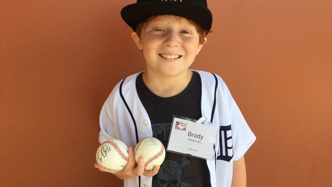 Brody Lutz, 10, of Birmingham had his jersey and a baseball signed by TIgers star Miguel Cabrera on Wednesday at the Detroit Economic Club Tigers Luncheon.