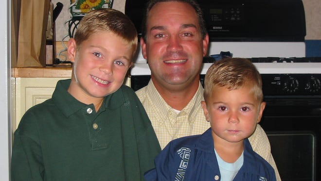 Richmond High School head coach Shawn Turner (center) with son Austin Turner (left) and younger son Nick Turner.