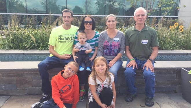 David Yakencheck, far right, sits next to Lydia Lanier, mom  of heart transplant donor Nicholas Lanier. Also pictured are Nicholas' sister Jessica, her husband Josh and their three children.