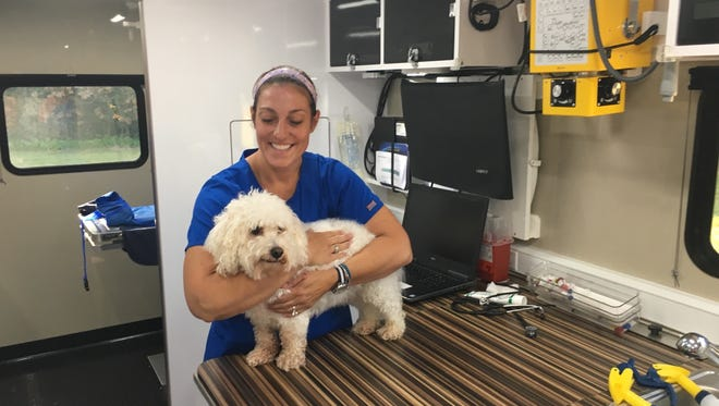 Dr. Amanda Fant, veterinarian, has a fully-equipped vehicle clinic equipped with the latest medical technology for pets.