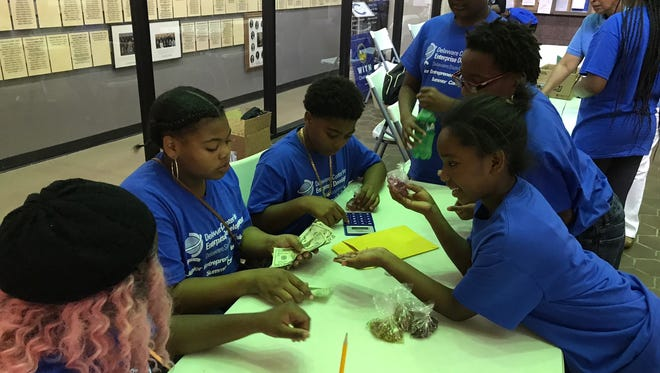 The Junior Entrepreneurs in Training, a Wilmington-based summer camp for fifth to eighth-grade students, sold their self-manufactured products at the Louis L. Redding City County Building Friday.