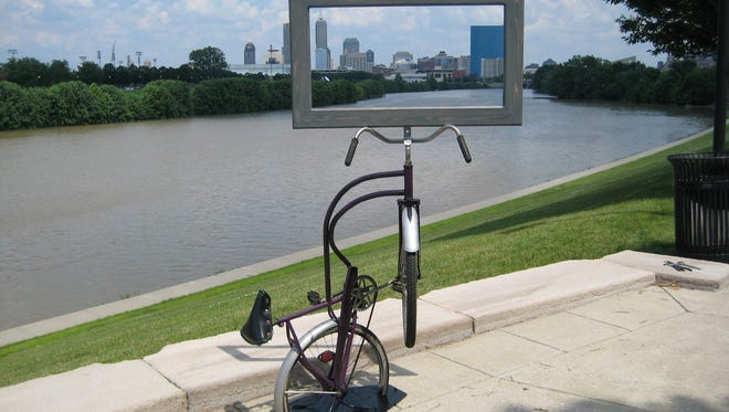 Artist Clyde Pennington created re-purposed bike sculptures along the White River.