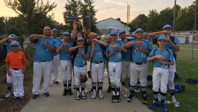 The Tulare All-Stars 12-and-under baseball team celebrates after one of their victories at the 2017 Cal Ripken World Series in North Carolina.