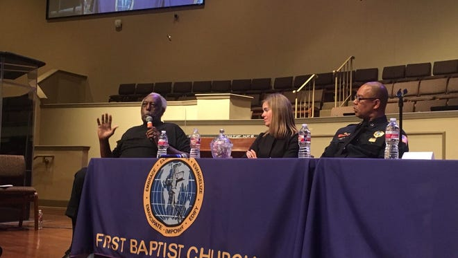 Rev. Eddie Brooks speaks about gun crime in his neighborhood while co-panelist Shelby District Attorney General  Amy Weirich and Memphis Police Director Michael Rallings listen.