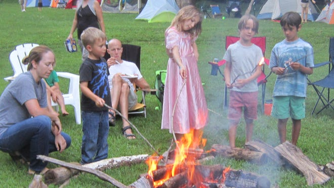 The Frenchtown Borough Park Campout on Saturday, Aug. 5,and Sunday, Aug. 6. Pictured are campers making s'mores.