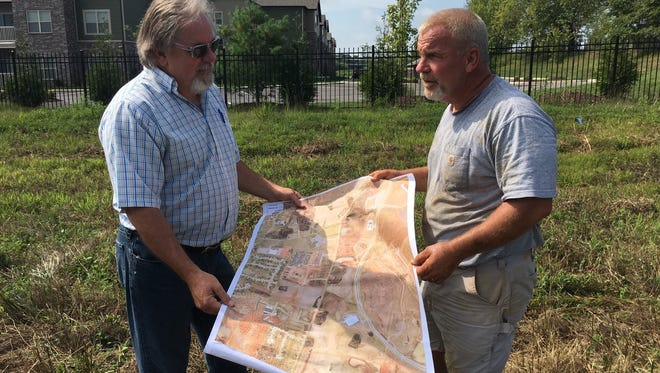 Local developers seeking rezoning for multi-family residential off Rollow Lane near the industrial park include Jimmy Settle, left, and Dennis Ziolkowski, right.