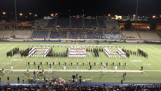 """The Abilene High band, in black, joins the Midland Lee band to play """"Amazing Grace"""" to honor those affected by Hurricane Harvey. Together, the bands spell """"Houston"""" at Grande Communications Stadium in Midland, where the football teams played a non-league game Friday night."""