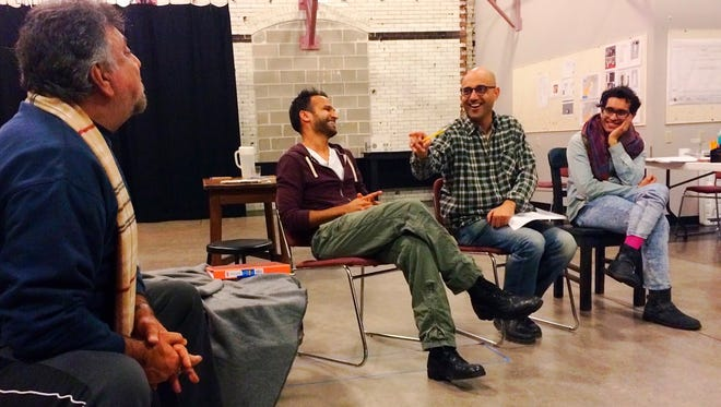 """Playwright Ayad Akhtar (second from right) with collaborate with the Milwaukee Repertory Theater on an adaptation and world premiere of """"American Dervish,"""" based on his novel. In this photo, Akhtar jokes with cast members of """"The Invisible Hand"""" during a 2016 rehearsal at the Milwaukee Rep."""