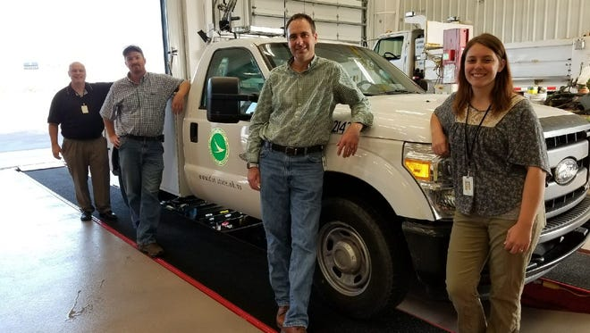 Ohio Department of Transportation opens new facility in Fremont. Pictured are ODOT District 2 Public Information Officer Rebecca Dangelo, near, with transportation manager Michael Leach, facilities administrator Greg Strausbaugh and human resource administrator Hiram Crabtree, far.