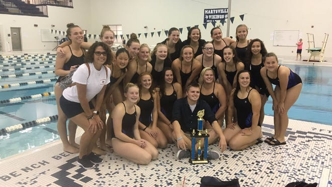 The St. Clair girls swim teams poses for a photo after winning the St. Clair County Meet.