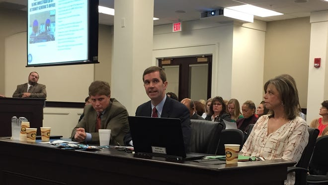Attorney General Andy Beshear (center) testified Thursday before a legislative committee.