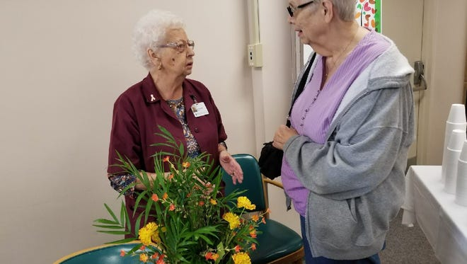 Bernita Herr, right, wishes Myrtle Koch a happy 100th birthday at ProMedica Memorial Hospital on Friday. The two worked together at the hospital for 20 years.