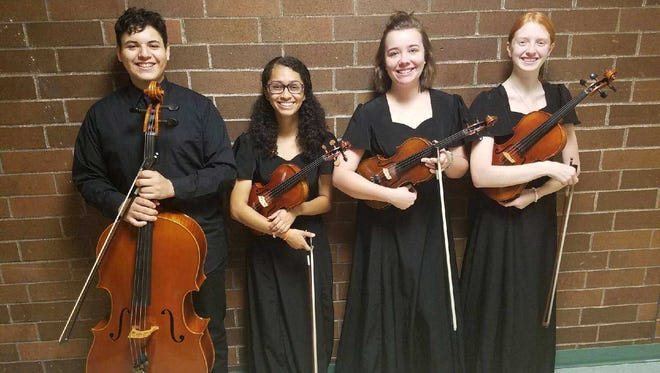 """McKay High School seniors Cindy Flores, Breanna Hargrove, Shae Skiles and sophomore Adrian Cervantes will join the """"Beatles vs. Stones: A Musical Showdown"""" traveling tour on Nov. 4 at the Elsinore Theatre."""