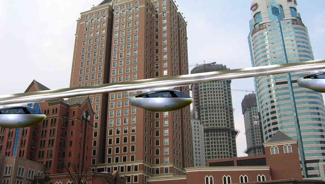 """Concept image of urban commuters riding skyTran's """"jet-like"""" rapid transit system utilizing magnetic levitation. The company wants to build a test track on 15 acres near Kennedy Space Center's former space shuttle runway, now operated by Space Florida."""