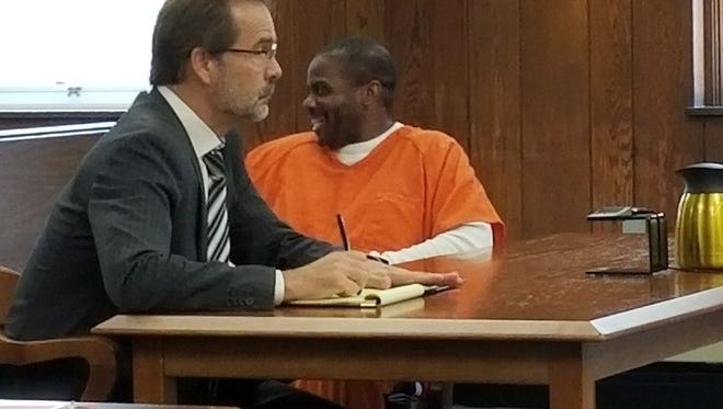 Keith Nettles smiles and waves at family right before being sentenced to 34 years for drug trafficking.