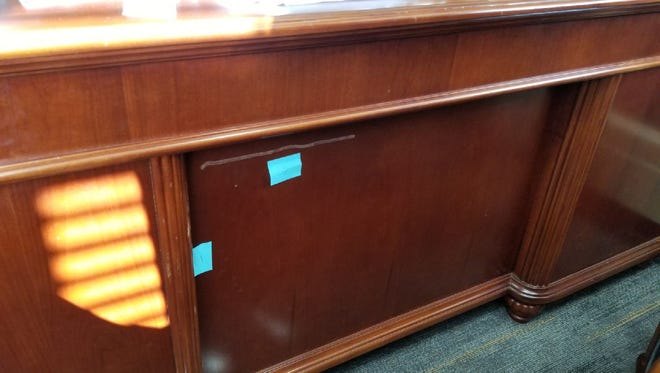 A large gouge seen on the front of Sandusky County Clerk of Court Tracy Overmyer's desk.