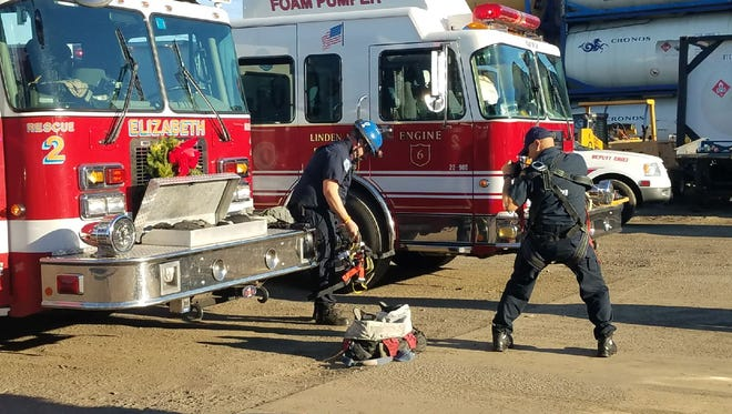 Emergency personnel worked to rescue a man in a confined space in Linden.