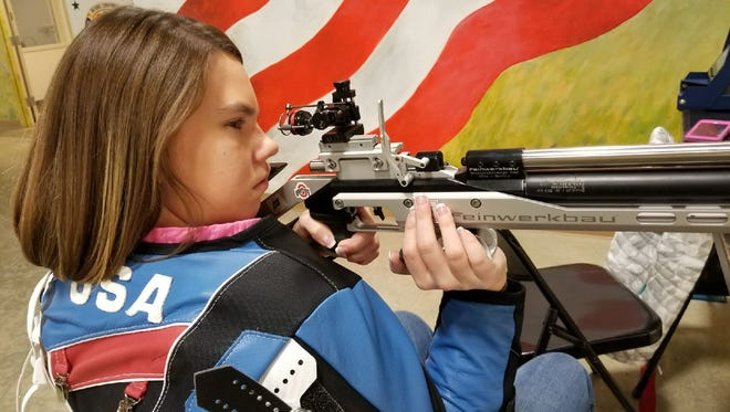 Taylor Farmer takes aim at a 10 meter target at the Gary Anderson Civilian Marksmanship Program Center at Camp Perry.
