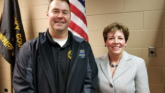 Sandusky County Sheriff Chris Hilton, left, will receive an additional $514,000 for his budget next year from Sandusky County Clerk of Courts Tracy Overmyer's title fund.