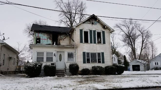 A mother and her infant child were displaced after their home caught fire Friday morning.
