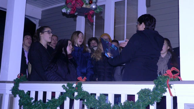 The Somerville High School Choir sang Christmas carols and songs at the annual Light up a Life tree lighting at the VNA headquarters on Main Street.