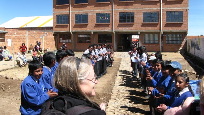 Rev. Jessica Crist is greeted by students in Bolivia.