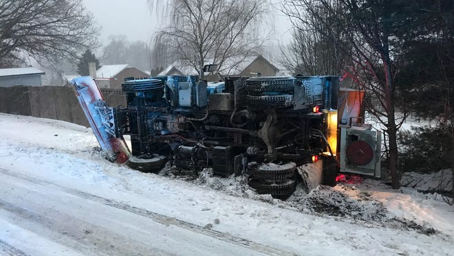 An overturned City of Clarksville sand truck on Ringgold Road Friday afternoon.