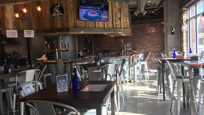 The restaurant space is open with a lot of natural light and high top tables.