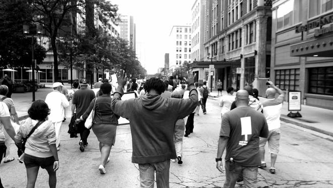 """A photograph by C.M. DeSpears called """"Hands Up, Don't Shoot"""" will be part of the ACLU's Gallery Night exhibit on April 20."""