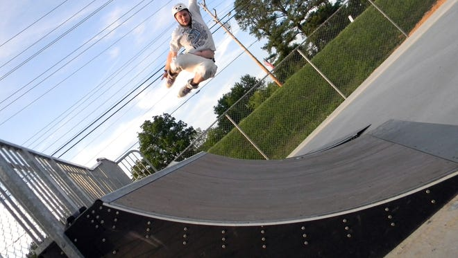Inline skater Paul Cathey, of White Bluff, grabs air off a ramp at the White Bluff Skate Park, which opened in 2013. An effort is under way in Erin to build a skate park.