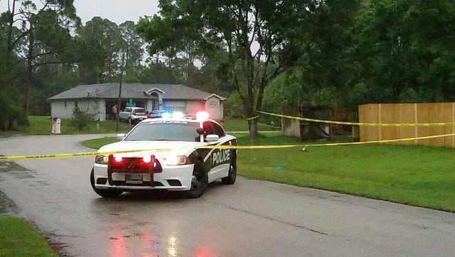 Police cordoned off the scene on Rila Street in Palm Bay.