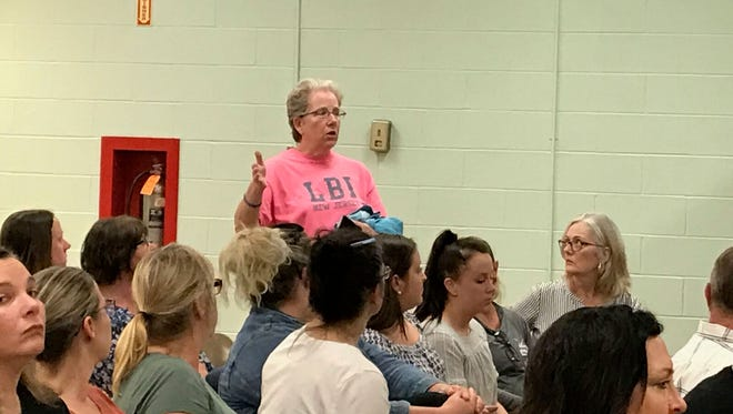 Laura Smith, a teacher's assistant at the Valley Program, talks about her concerns of the new healthcare coverage for aides during the May 21 Northern Valley Regional school board meeting.