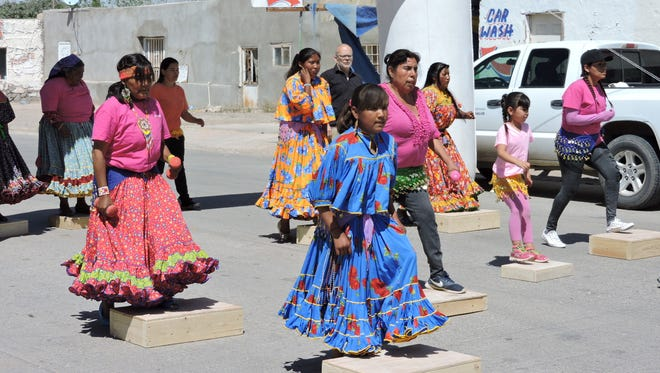 In contrast, the Tarahumara women are performing a Zumba demonstration with the women in leotards. Modernism meets traditionalists during the annual Earth Day celebration in Palomas, Chih. Mexico. The Tarahumara women in traditional dress joined others in leotards and t-shirts during the Zumba demonstration led by Border Partners' health promoter Juana Flores. Health promoters (promotoras) also staffed booths offering healthful burritos and health screenings. The celebration included entertainment, music and a jump house for children. Vendors sold items made from recycled materials.