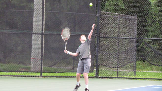 Deklan Hand, who plays for the 14-under Boro Savage Servers team, competes in recent Junior Team Tennis action. Hand and the Savage Servers will be competing in this weekend's JTT state championships in Murfreesboro.