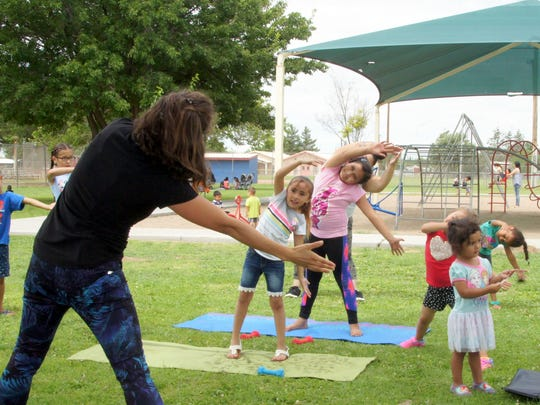 The Summer Burn Into Fitness program draws an average of 20 participants for a fun-filled workout at three city parks.