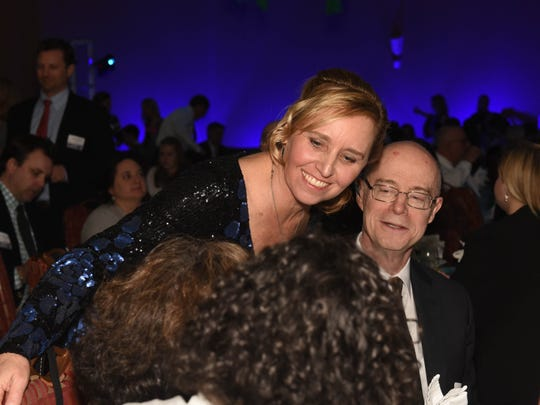 Kelly Devine, executive director of the BBA Burlington Business Association, hugs John Killacky, executive director of the Flynn Center for the Performing Arts, center, before the Flynn Center was honored with the 2015 Architectural Excellence Award in honor of Hertzel N. Pasackow at the BBA dinner.