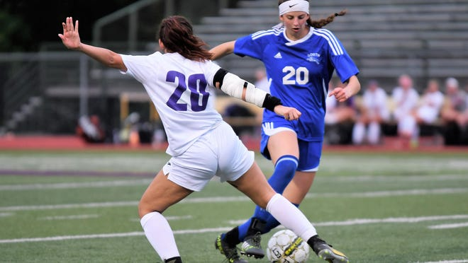 Blue Springs South's Khiara Cox, right, tries to get past Blue Springs defender Kirsten Barajas during a 2018 game. Cox will be one of three South seniors who will get to play one final weekend after their 2020 season was wiped out by the coronavirus pandemic.