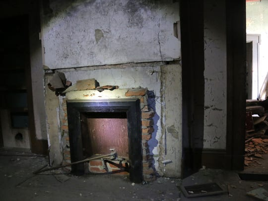 The fireplace is one of many things slated to be renovated in the 1868 house on the corner of Fifth and Walnut.