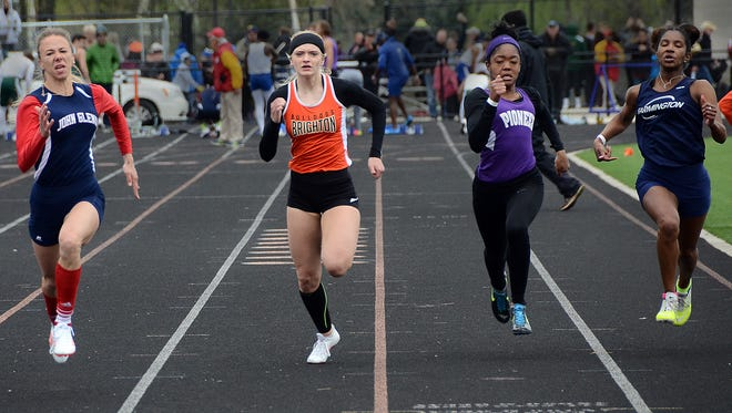 Brighton's Shannon McGrath (second from left) made the All-Livingston County track and field team in three events.