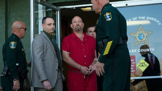 Mark Sievers, center, is led from the Lee County Sheriff's Office headquarters after being arrested on Friday, Feb. 26, 2016, in Fort Myers. Sievers was arrested on a second-degree murder charge in connection with the June 2015 death of his wife, Dr. Teresa Sievers. (David Albers/Naples Daily News)